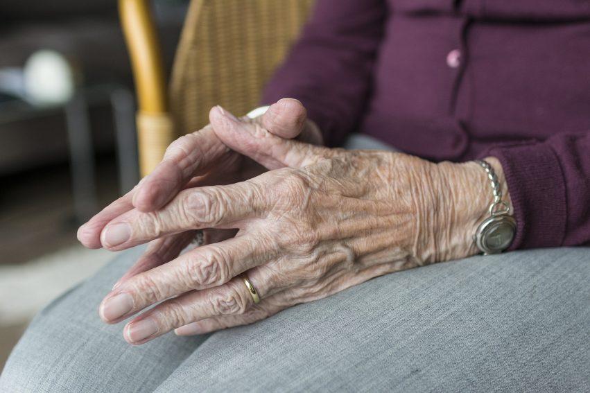 older person hands regret